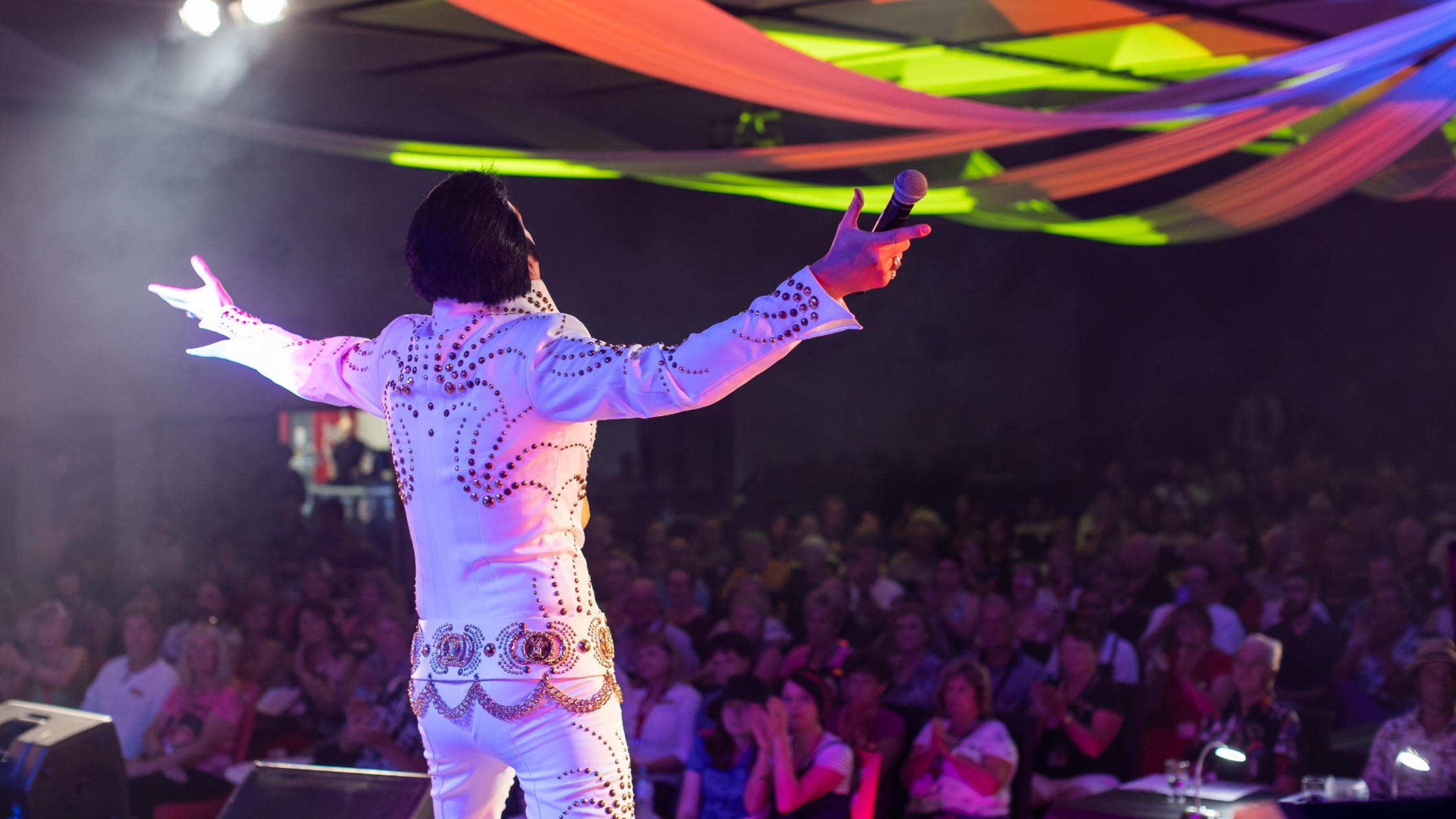 The audience watch the main stage of the Parkes Elvis Festival
