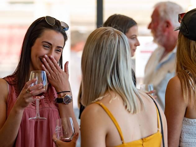 Shedfest people enjoying wine