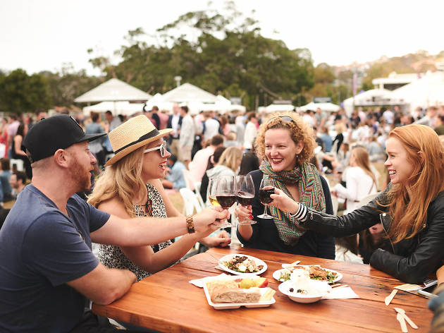 People holding red wine glasses at Hunter Valley Uncorked Balmoral.
