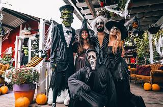 People dressed in witch and ghost costumes for Halloween at the Grounds of Alexandria.
