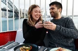 A couple smiles while they ride the Luna Park Ferris Wheel