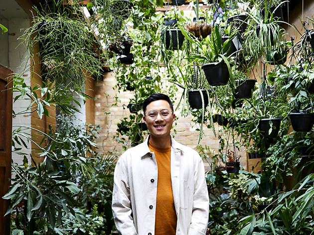 Jason Chongue surrounded by plants