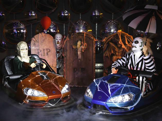 Beetlejuice and random man in costume driving dodgem cars