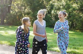 Women running in their pyjamas