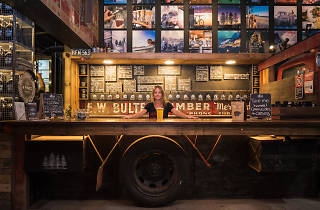 A beer bar on the back of an old pickup truck
