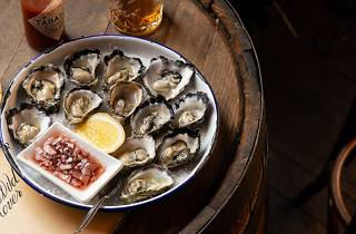 A plate of Sydney rock oysters and whisky at Wild Rover Oyster Fest