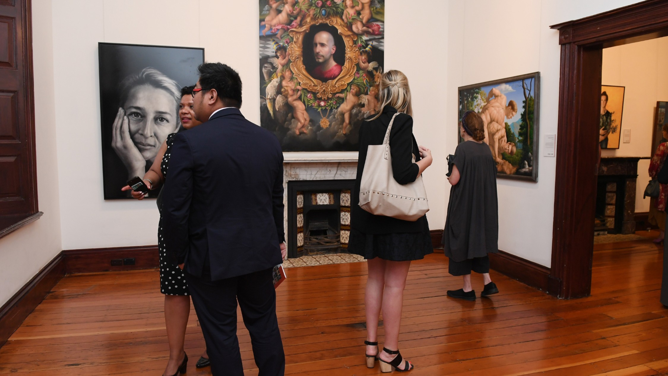 People viewing the Doug Moran National Portrait Prize