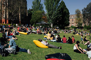 People lounging on the Abbotsford Convent lawns