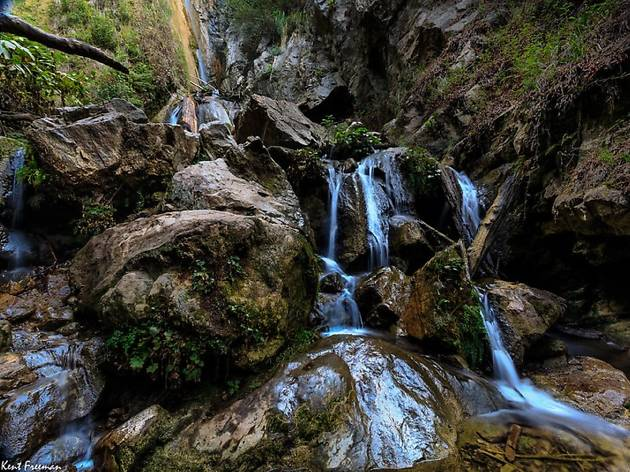 A waterfall over rocks in the forest