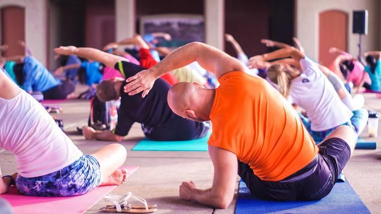 People performing yoga