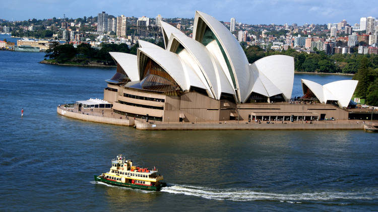 Boat in Sydney Harbour next to Sydney Opera House