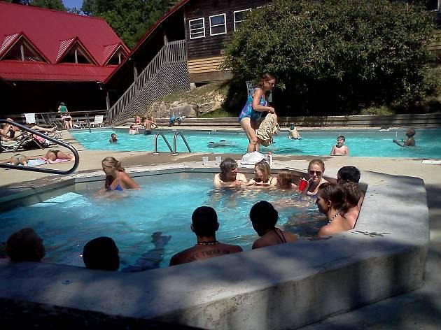 People in hot springs pools