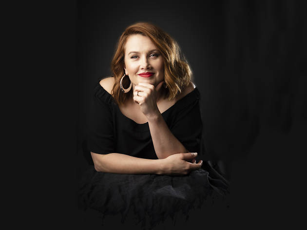 Singer/actor Clare Bowditch smiling at the camera.