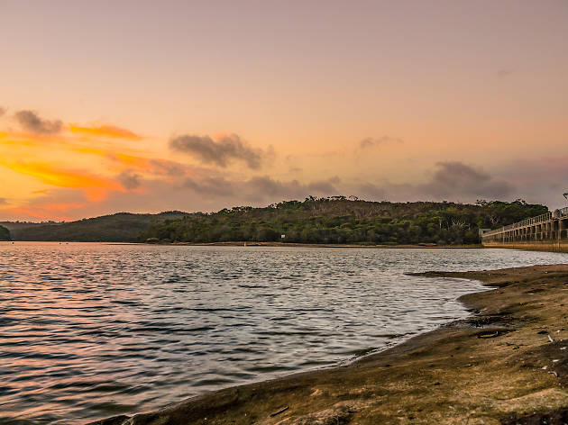 Manly Dam at sunset on the shores.