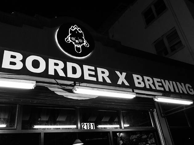 A black and white photo of the sign Border X Brewing