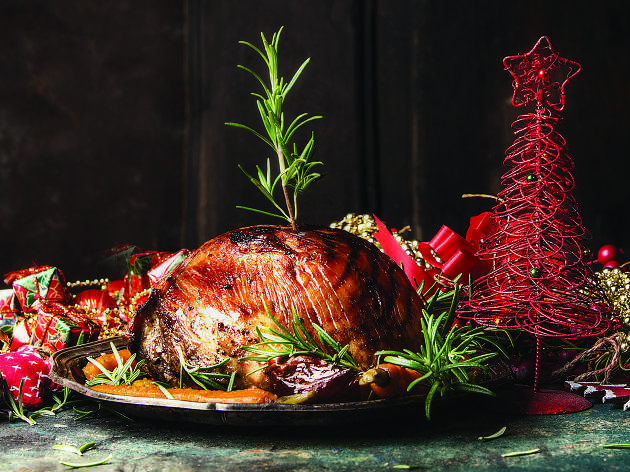 A roast meat on a Christmas platter.