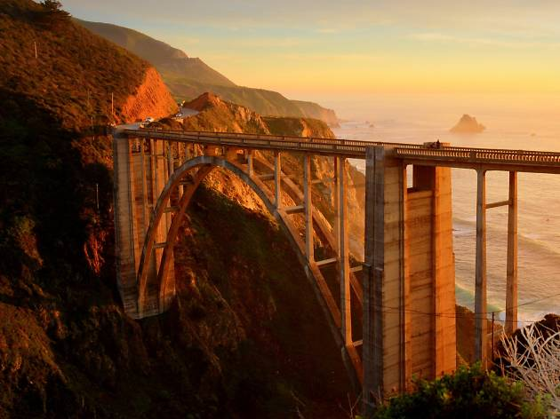 The iconic Bixby Bridge in the sunset with the ocean in the background