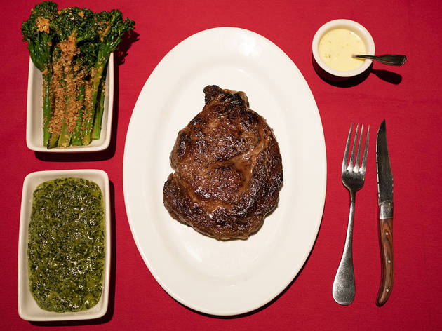 <p>The 18-ounce rib eye with broccolini, creamed spinach and b&eacute;arnaise</p>