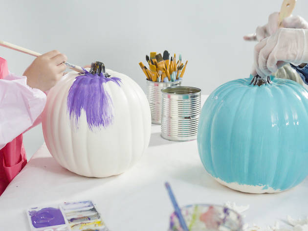 Kids painting pumpkins multicoloured.