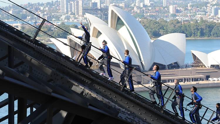 People scaling the Harbour Bridge on the BridgeClimb