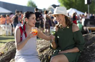 Two women drinking wine outdoors