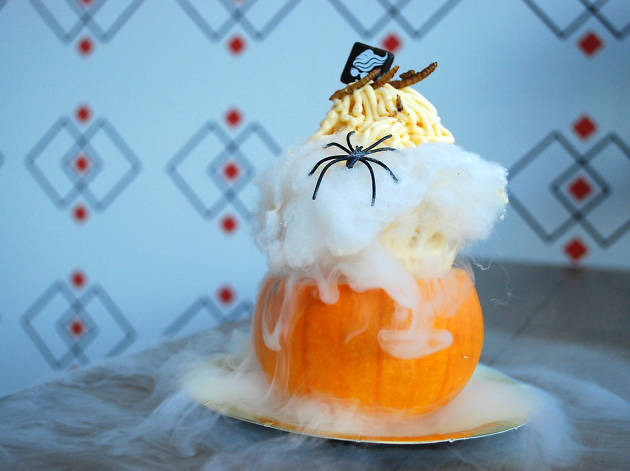 A pumpkin topped with noodles of gelato and mealworms