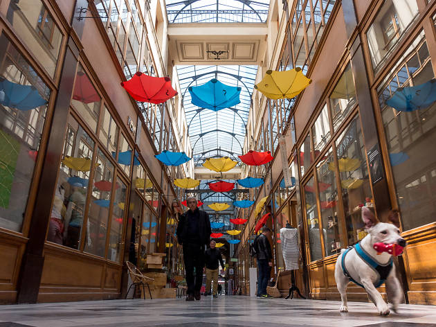 An installation of umbrellas at the Passage du Grand Cerf covered passage in Paris