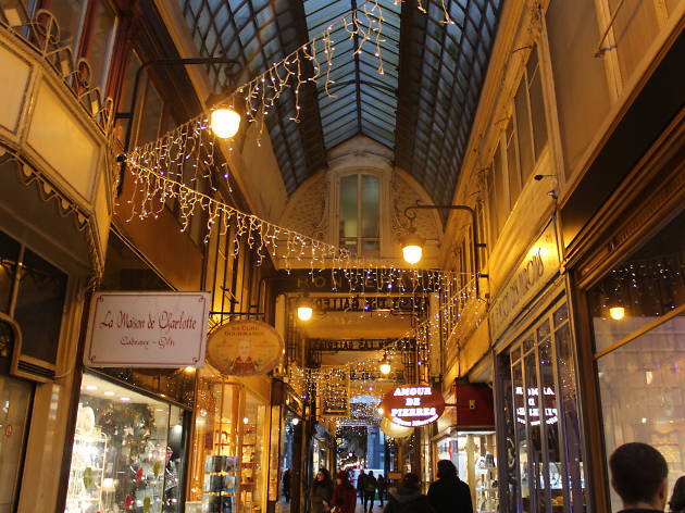 Inside the Passage Jouffroy covered passage in Paris at night