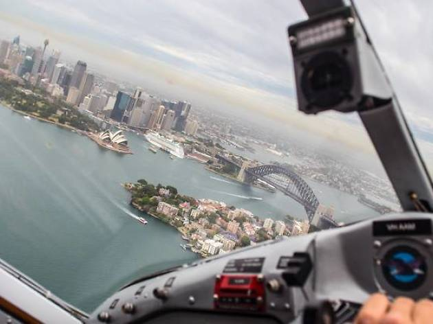 A pilot flys over Sydney Harbour