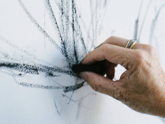 Hand drawing with charcoal on a white surface