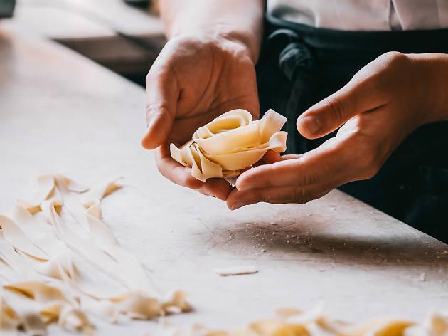 Hands holding a pasta nest