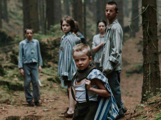 Escaped child concentration camp inmates in a forest