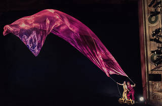 Characters in children's theatre show Air Play hold a long purple scarf in the wind.