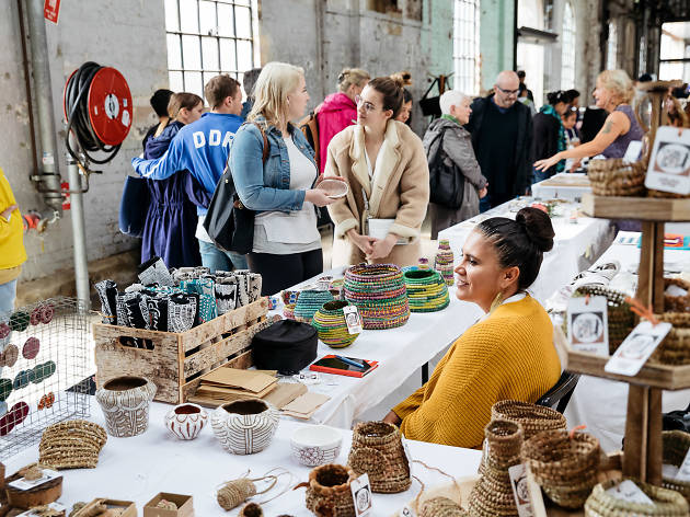 People shopping at stalls at the Southeast Aboriginal Arts Market Carriageworks.