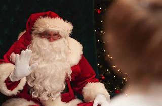 Santa waving at a small child