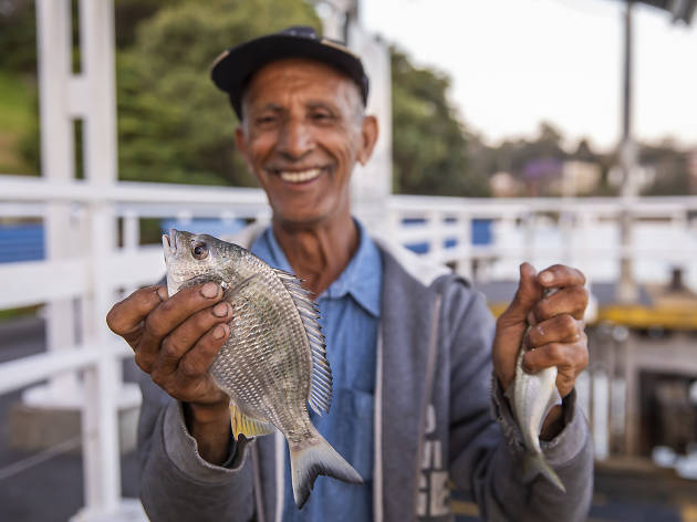Man holding fish at Huntleys Point Wharf in Gladesville.