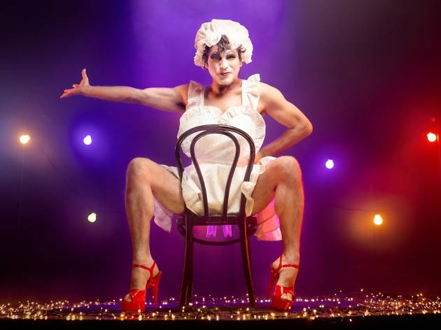 A man in drag on a chair