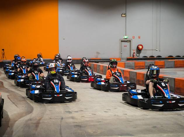 People in go-karts at Ultimate Karting Sydney.