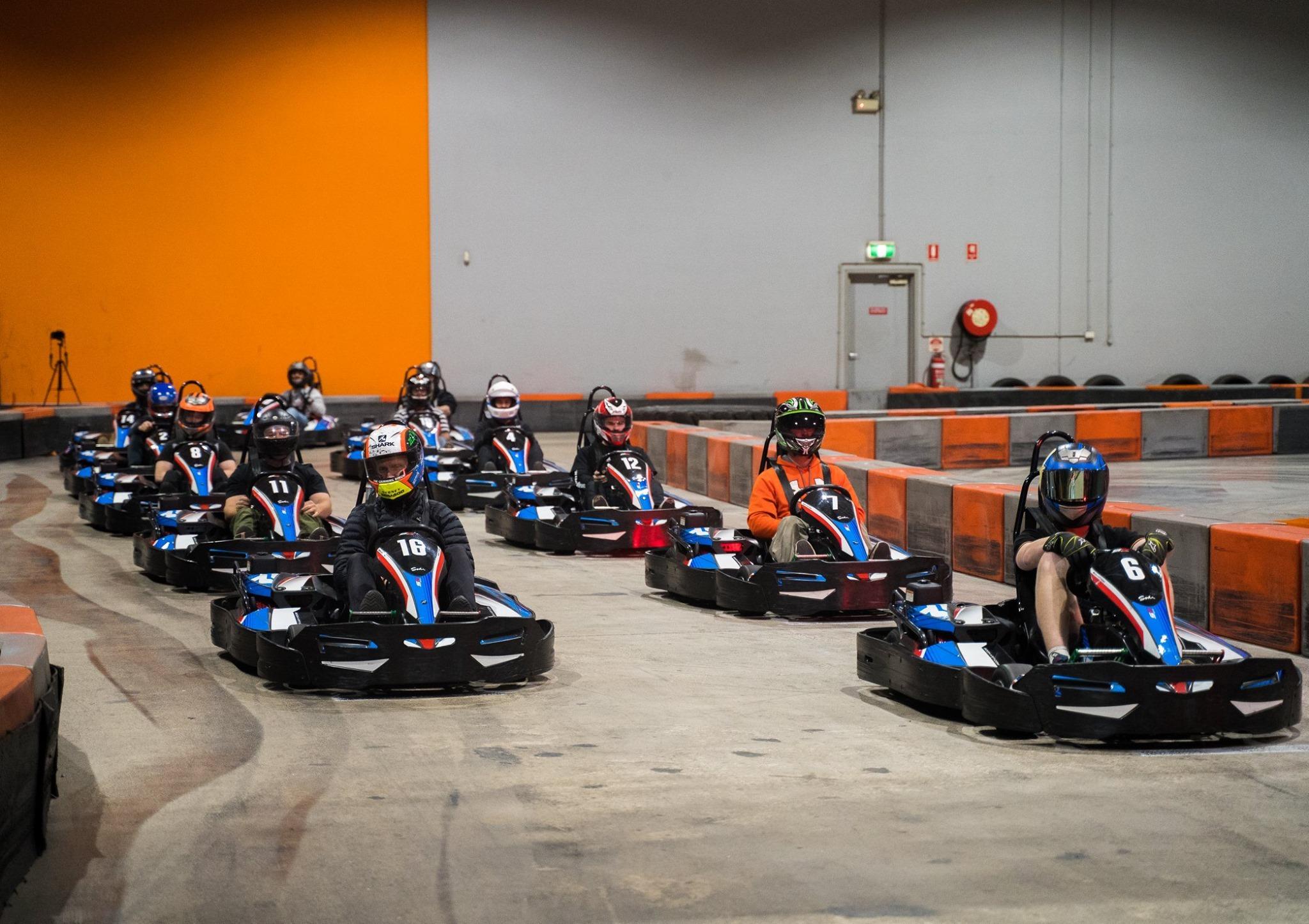 People in go-karts at Ultimate Karting Sydney.