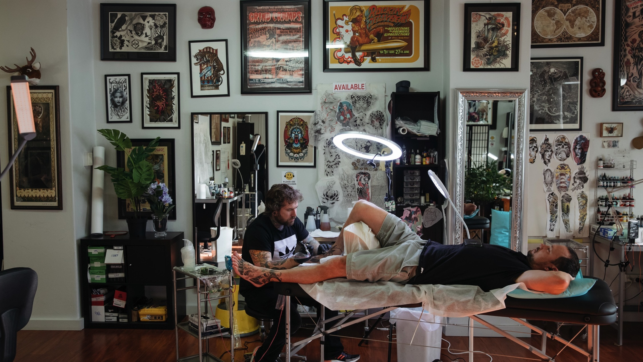 Person getting a tattoo insdie at Hibernia Tattoo