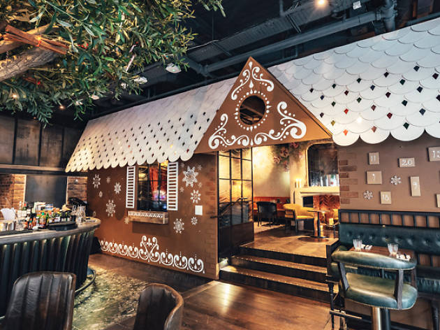 A giant gingerbread chalet just appeared inside a London pub