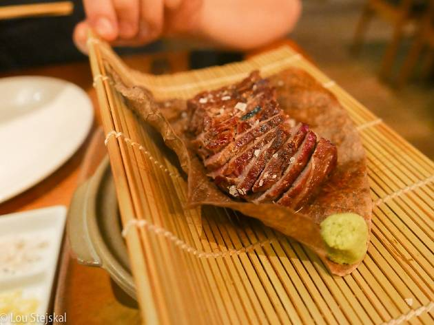 Sliced beef on a bamboo mat