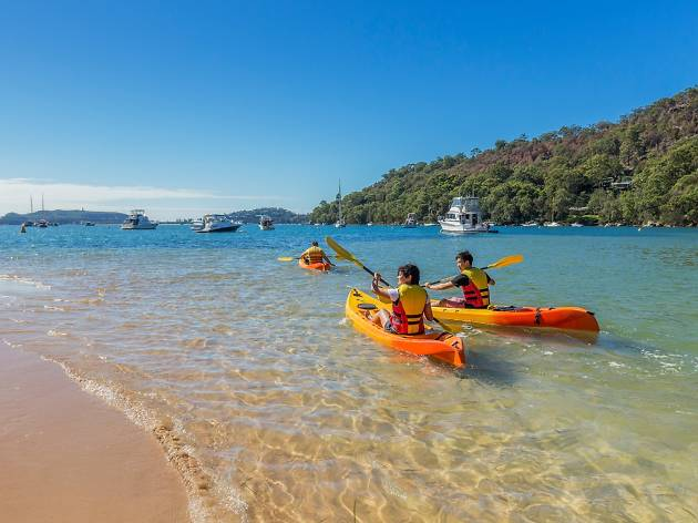 People kayak on Pittwater Bay