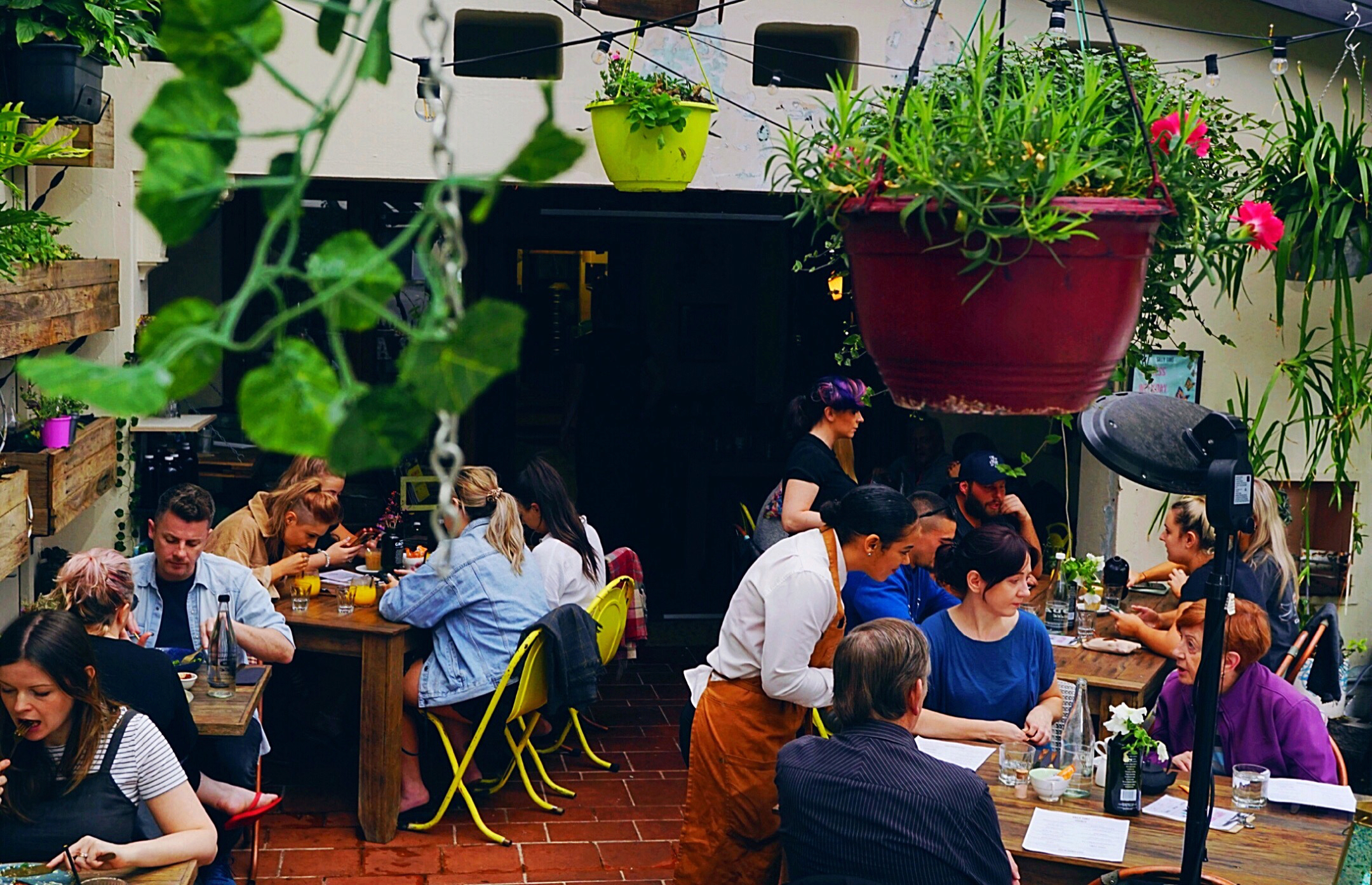 People having lunch in the courtyard at the Silly Tart Kitchen