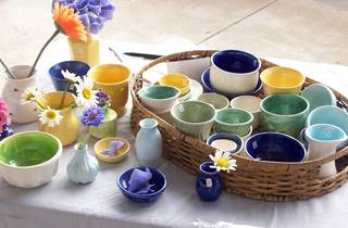 Handmade ceramic mugs and bowls at a market stall