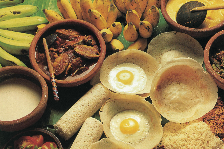 A table og egg hoopers, dosa and bananas.