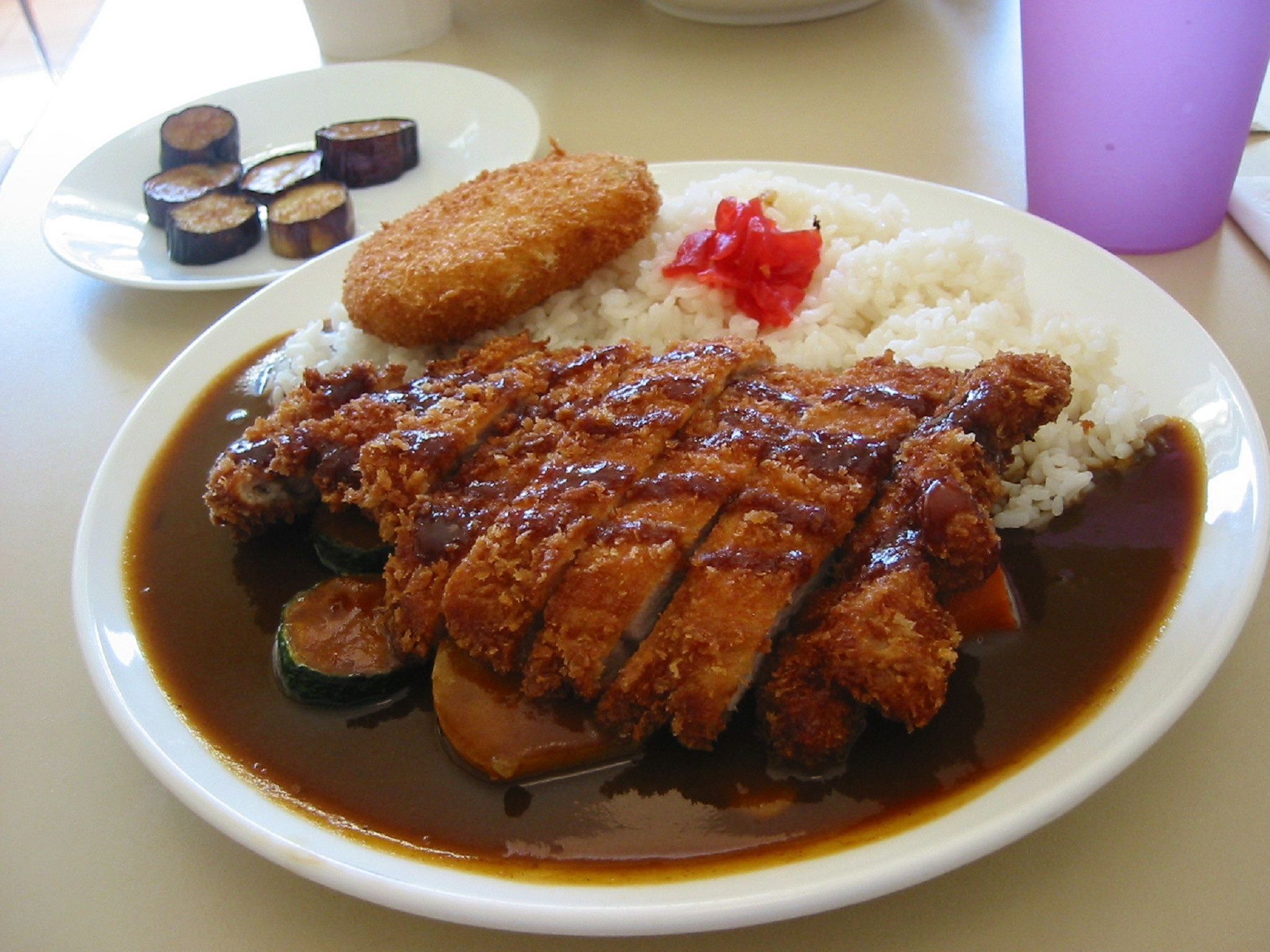 A plate of pork curry with rice