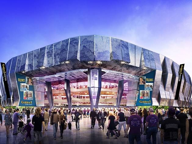 The shiny exterior of the Golden 1 Center with people entering and exiting
