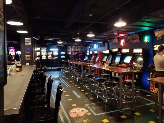 The arcade-like interior of a bar
