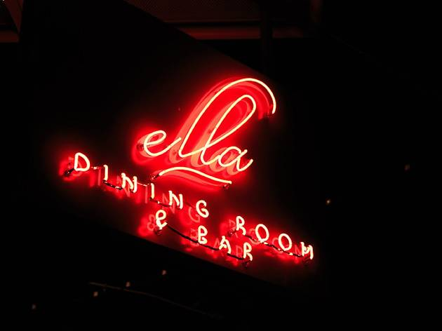 A neon sign that says Ella Dining Room & Bar